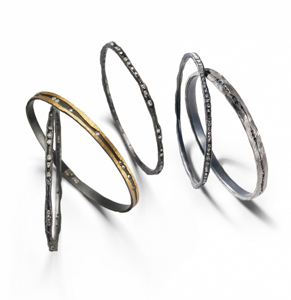 Todd Pownell, Bracelets -oxidized silver, inverted diamonds